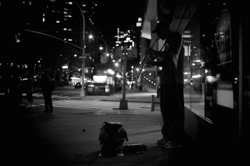 street musician city night