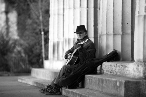 Street Musician Playing A Guitar