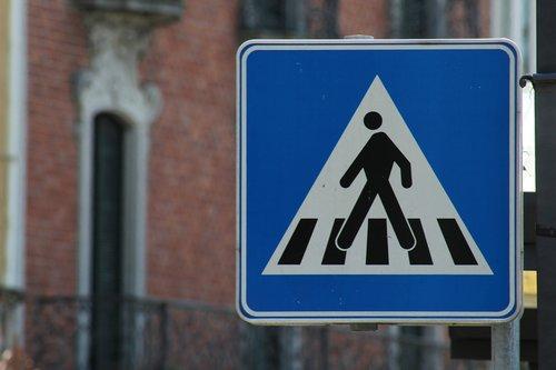 street sign  crosswalk  pedestrian