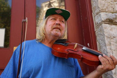 street vendor  musician  homeless