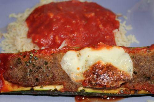 stuffed zucchini rice tomato sauce