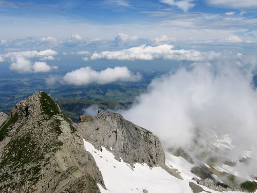 summit mountain clouds