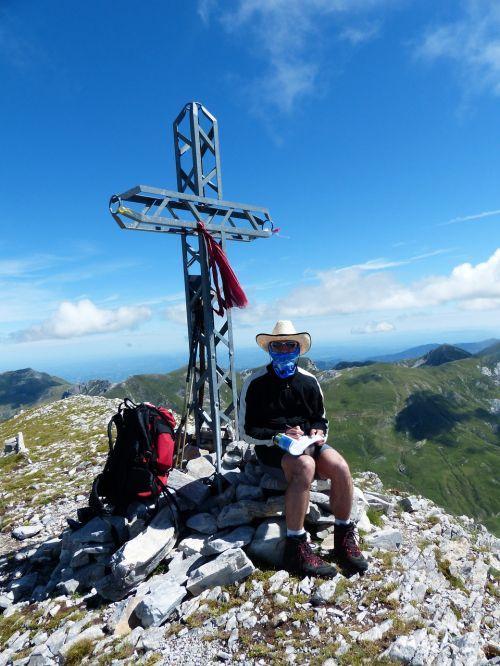 summit cross man person