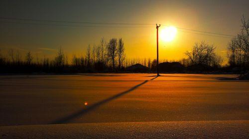 sun snowy roads