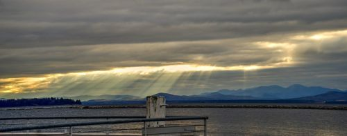 sun rays mountains lake champlain