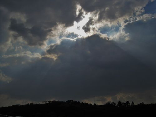 Sun Rays Over Clouds