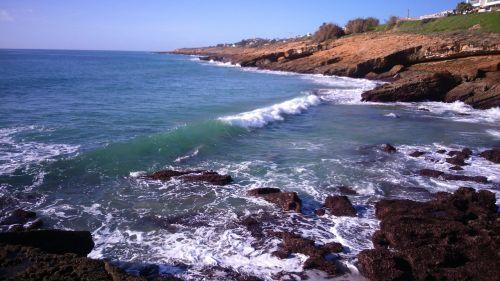 sun sea rocks sky scenery shoreline