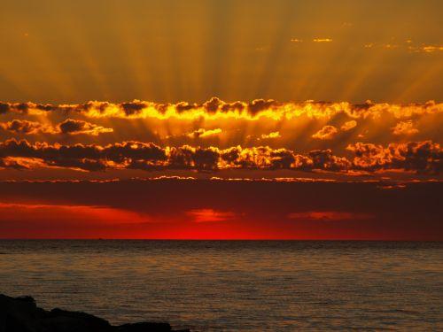 sunbeam sunset water