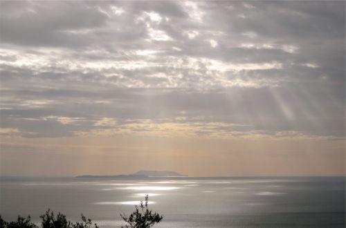 sunbeams clouds sky