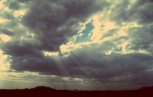 sunbeams sky clouds