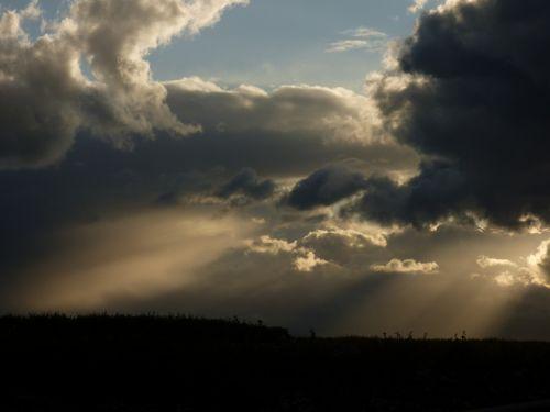 sunbeams clouds evening light