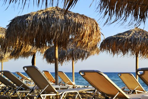 Sunbeds And Umbrellas By The Sea