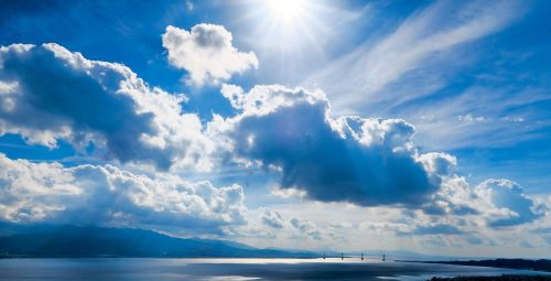 sunlight,sunshine,sunny,day,blue,sky,clouds,mountain,sea