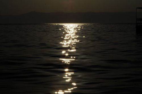 sunrise sparkling the water