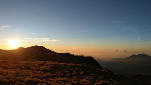 sunrise the odd knight of the south peak alpine