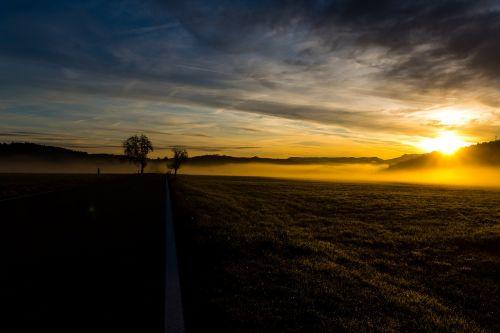sunrise fog landscape
