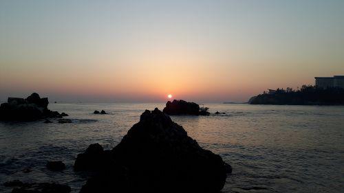 sunrise dawn the body of water