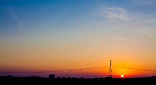 sunset,sky,sun,nature,sunrise,sunset sky,landscape,sky clouds,outdoor,orange,horizon,evening,light,sunset background,sunrise sky,dusk,blue sky