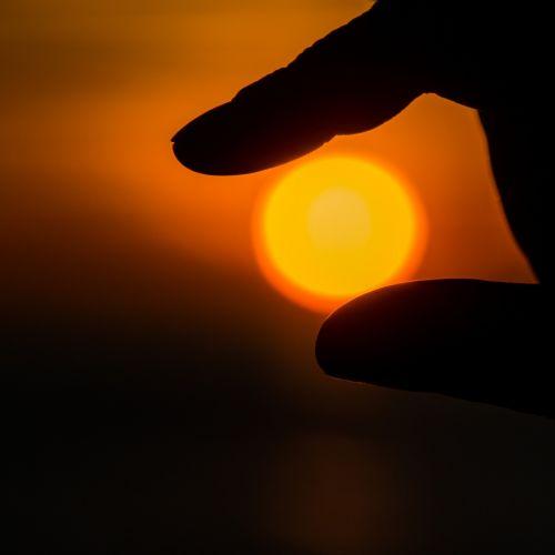 sunset sun hand
