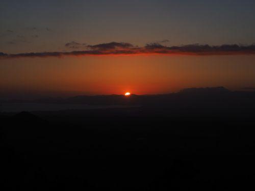 sunset solar disk fireball