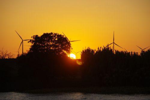 sunset windmills horizon