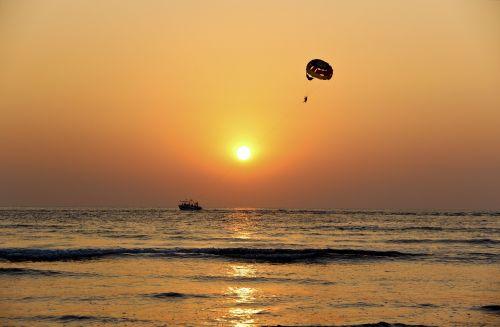 sunset flying beach