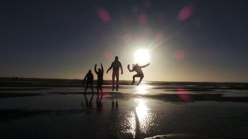 sunset beach back light