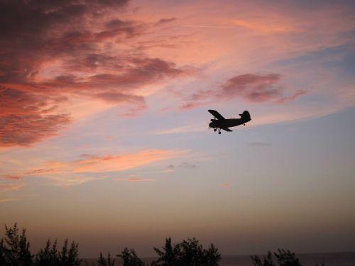 sunset cuba biplane