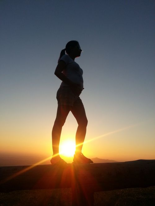 sunset pregnancy woman