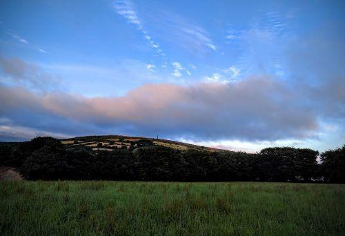 sunset clouds hills