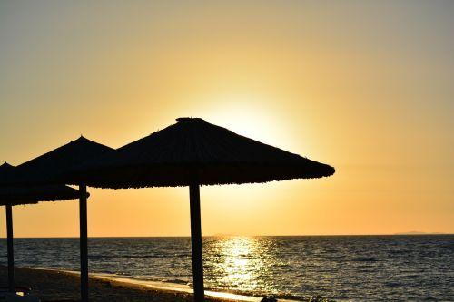 sunset sea parasols