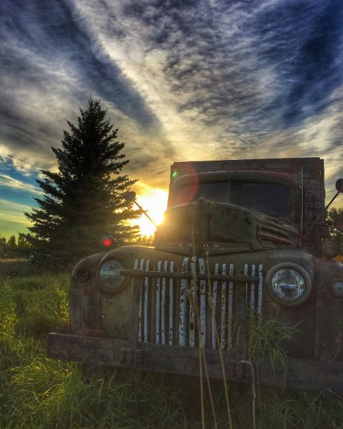 sunset manitoba old truck