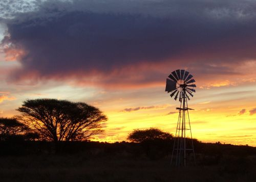 sunset wind mill africa