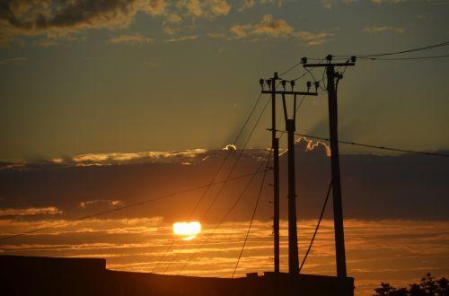 sunset masts power poles