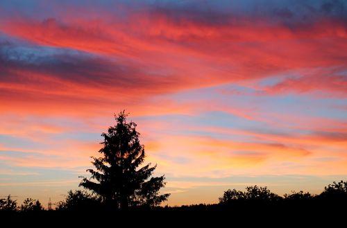 saulėlydis,spalvų riaušės,siluetas,vakaras