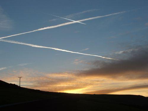 sunset contrails condensation trails