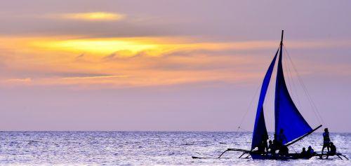 sunset sailing boat