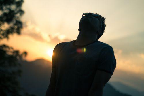 sunset man thinking