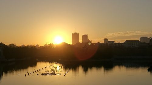 sunset riverside building