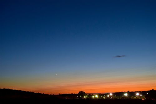 sunset crescent moon city lights