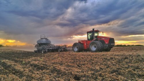 sunset clouds tractor