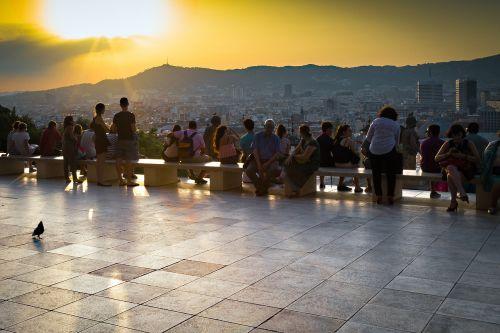 sunset barcelona tourists