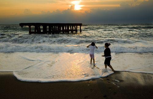 sunset children horizon line