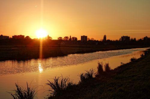 sunset waterway reflection