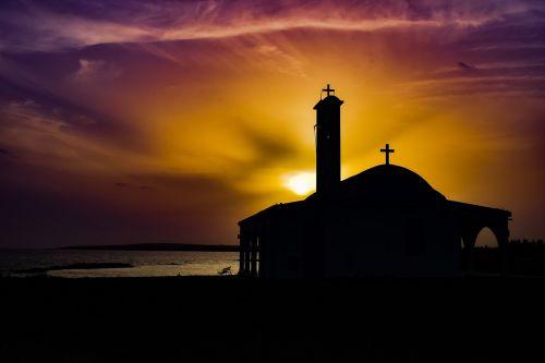sunset,dusk,evening,silhouette,light,sky,clouds,colorful,sea,horizon,church