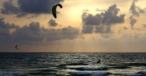 sunset sea windsurfing
