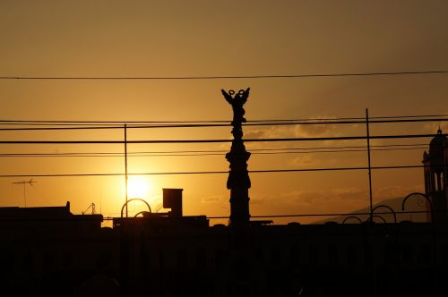 sunset statue religion