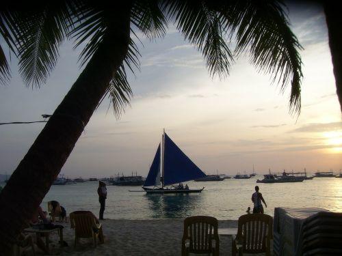sunset sailboat boracay island
