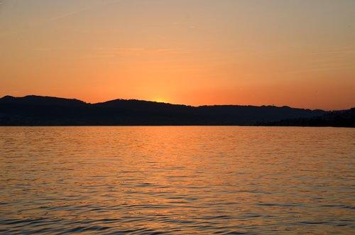 sunset  waters  lake zurich
