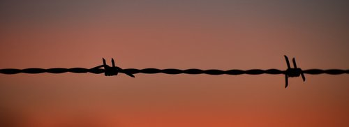 sunset  silhouette  barb wire fence